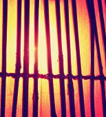 a bamboo lamp toned with a retro vintage instagram filter effect