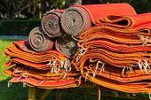 Pile Of Red Asian Rattan Mat