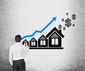 Businessman Drawing Chart And House