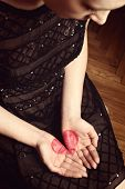Girl looking at heart shape on her palms