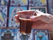Woman Holding Hot Tunisian Tea