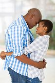 passionate young african couple hugging with eyes closed