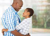 portrait of loving african couple hugging