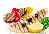 Grilled fish fillet with tasty vegetables.