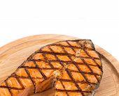 Grilled salmon steak on platter