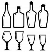 isolated bottles and alcohol glass set