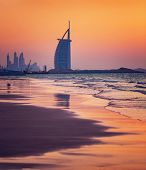 DUBAI, UAE - NOV 24: Burj Al Arab is 321m, second tallest hotel in the world, luxury hotel stands on an artificial island,November 24, 2014 Jumeirah beach, Dubai, United Arab Emirates