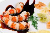 Fried shrimp with soy sauce as a background.