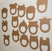 image of laughable  - Set of cardboard masks on a white brick wall - JPG