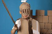 foto of berserk  - photo of the boy in medieval knight costume made of cardboards - JPG