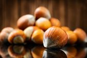 Raw Organic Whole Hazelnuts on wooden background. Selective focus