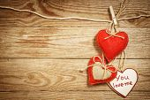 Valentine's Day card made in eco loving concept on a vintage wooden background.