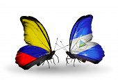 Two Butterflies With Flags On Wings As Symbol Of Relations Columbia And Nicaragua