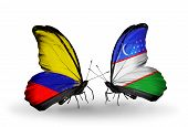 Two Butterflies With Flags On Wings As Symbol Of Relations Columbia And Uzbekistan