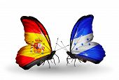 Two Butterflies With Flags On Wings As Symbol Of Relations Spain And Honduras