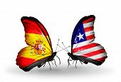 Two Butterflies With Flags On Wings As Symbol Of Relations Spain And Liberia