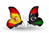 stock photo of libya  - Two butterflies with flags on wings as symbol of relations Spain and Libya - JPG