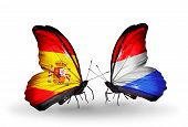 Two Butterflies With Flags On Wings As Symbol Of Relations Spain And Luxembourg