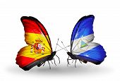 Two Butterflies With Flags On Wings As Symbol Of Relations Spain And Nicaragua