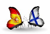 stock photo of spanish money  - Two butterflies with flags on wings as symbol of relations Spain and Finland - JPG