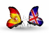 stock photo of spanish money  - Two butterflies with flags on wings as symbol of relations Spain and UK - JPG