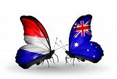 stock photo of holland flag  - Two butterflies with flags on wings as symbol of relations Holland and Australia - JPG