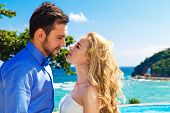 Happy Bride And Groom On A Tropical Beach
