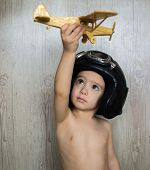 Portrait of child with airplane traveling toy