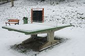 Ping Pong Table In A Park During Snowstorm