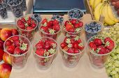 Strawberries And Blueberries In Cups