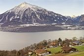 Lakeview Over Swiss Apls Mountains In A Swiss Village Near The Thun Lake In Winter