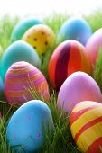 Many Colorful Easter Eggs On Green Grass