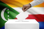 Ballot Box With National Flag On Background - Comoros