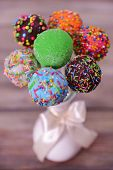 image of cake pop  - Sweet cake pops in vase on wooden background - JPG