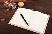 Blank recipe book on wooden background