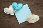 Sweet Love Hearts And Blue Blank Paper On Wood