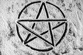 pic of pentagram  - Old steel Pentagram closeup photo on powder - JPG
