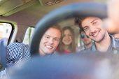 Young people having vacation enjoying fun driving car