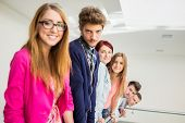 Young people standing on line in real authentic life