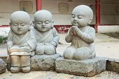Stone Statue Of Learning And Relax Chinese Monks