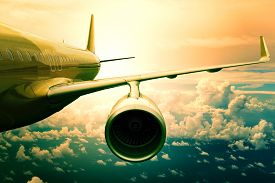stock photo of aeroplan  - passenger jet plane flyin above cloud scape use for aircraft transportation and traveling business background - JPG
