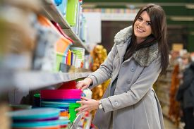 picture of department store  - Beautiful Young Woman Shopping For Bowl In Produce Department Of A Grocery Store  - JPG