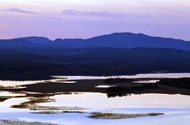 stock photo of nightfall  - Nightfall up North over lakes - JPG