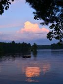 picture of dock a lake  - Bright cloud at sunset reflecting on lake water with trees and swimming dock - JPG