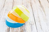foto of ceramic bowl  - Close up colorful ceramic bowl on the wooden background - JPG