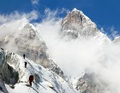 stock photo of mountain-climber  - group of climbers on mountains montage to mount Lhotse Everest area Khumbu valley Nepal - JPG