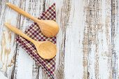 picture of tablespoon  - Wooden spoons on checkered cloth lying on wooden surface - JPG