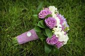 image of bouquet  - picture of a wedding bouquet Wedding bouquet of pink and white roses lying on grass - JPG