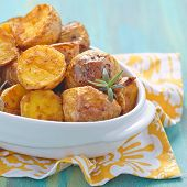 image of baked potato  - Oven baked potatoes with rosemary in a baking dish - JPG