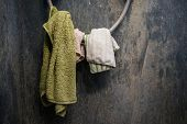stock photo of dirty  - Hanging dirty towel and cotton on shower wire with dirty grunge concrete wall in toilet - JPG